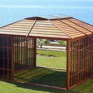 Sun Gazebo (Options: 12' L, 12' W, Mature Redwood, 4' x 8' Skylight, No Flooring, Transparent Premium Sealant). Photo shows all front and rear panels hidden behind front panel for maximum openness. Side wall panels can also be opened or even removed.
