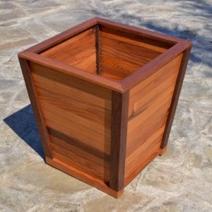 "Tapered Planter (Options: 15"" Square Base x 21"" Square Top x 18""H, Mature Redwood, 3/4-inch feet, Seal interior and exterior of box, Transparent Premium Sealant)."