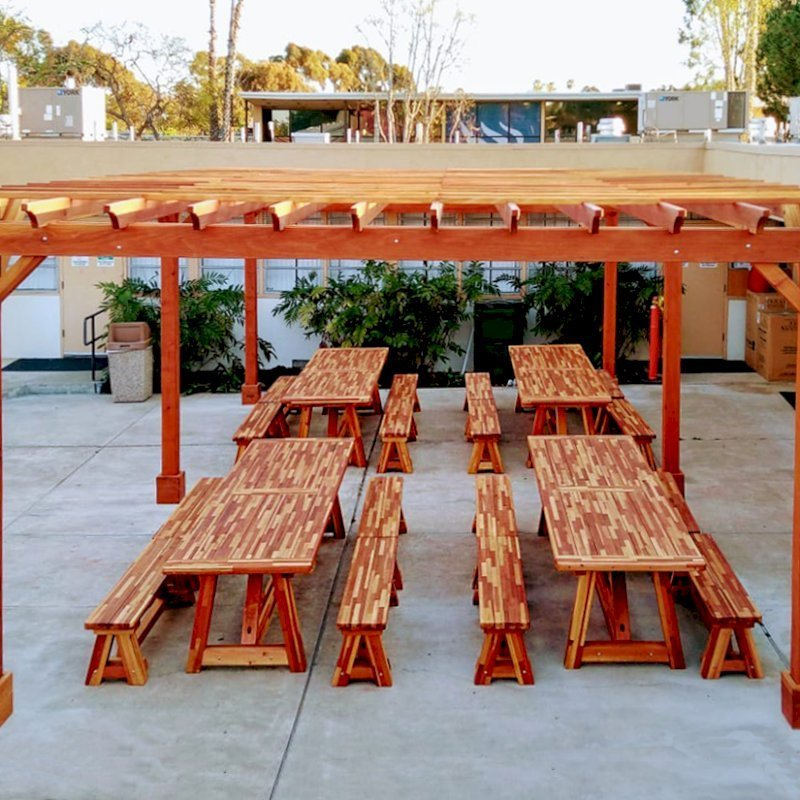 """The Classic Redwood Patio Table (Options: 10' L x 36"""" W, Mosaic Reclaim Wood, Side Benches, 2 Half Length Benches Per Side, Old Country Tabletop, Standard, Slightly Rounded Corners, No Umbrella Hole, Transparent Premium Sealant). Photo Also Shows a Garden Pergola. Photo Courtesy of T. Sirvent. Tables Installed in Vanguard University, Costa Mesa, CA."""