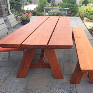 "The Classic Redwood Patio Table (Options: 8' L, 34 ½"" W, Side Bench, Mature Redwood, 1 Full Length Side Bench on One Side, Custom Tabletop [3-Plank Bookmatch Top], Slightly Rounded Corners, No Umbrella Hole, Transparent Premium Sealant). Photo Courtesy of J. Gannon of Broomfield, CO."