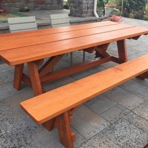 "The Classic Redwood Patio Table (Options: 8' L, 34 ½"" W, Side Bench, Mature Redwood, 1 Full Length Side Bench on One Side, Custom Tabletop [3-Plank Bookmatch Top], Slightly Rounded Corners, No Umbrella Hole, Transparent Premium Sealant). Photo Courtesy of J. Gannon of Broomfield, CO"