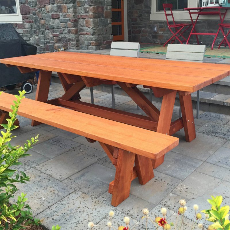 """The Classic Redwood Patio Table (Options: 8' L, 34 ½"""" W, Side Bench, Mature Redwood, 1 Full Length Side Bench on One Side, Custom Tabletop [3-Plank Bookmatch Top], Slightly Rounded Corners, No Umbrella Hole, Transparent Premium Sealant). Photo Courtesy of J. Gannon of Broomfield, CO."""