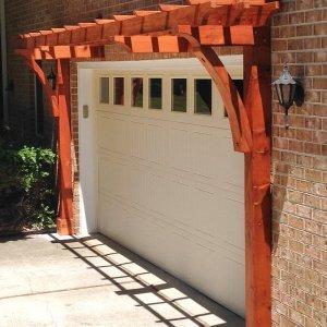 "Custom Garage Arbor (Options: 20' x 24"", Mature Redwood, 9 ft Posts by Custom Request, Transparent Premium Sealant). Photo Courtesy of Josef Messmer of Fayetteville, Pennsylvania."
