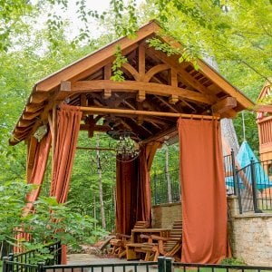 The Granada Pavilion (Options: 6in x 6in post thickness, 18' L x 15' W, California Redwood with a 15-year warranty, 4-post Anchor Kit for Gale-Wind, Electrical Wiring Trim for 1 Post, 3 Ceiling Fan Bases, 4 Curtain Rods, Transparent Premium Sealant). Photo Courtesy of J. Rynerson of Franklin, Tennessee.