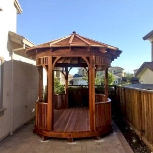 """Custom  Hexagonal Retreat Pavilion (Options: 15' L x 10'-6"""" W, Oval Shape Instead of Hexagonal by Custom Request, with Deck, California Redwood, With Upper Corvels and Lower Panels, Transparent Premium Sealant). Photo Courtesy of A. Singh of Dublin, California."""