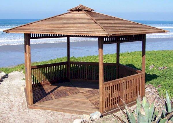 The Hexagonal Retreat Pavilion (Options: 14' Diameter, Add a Deck, Mature Redwood, With Upper and Lower Panels, Transparent Premium Sealant).