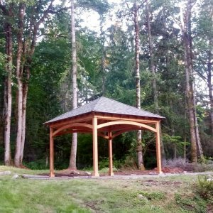 The Loreto Pavilion (Options: 15' L x 15' W, No Privacy Panels, Douglas-fir, 9.5' H, No Electrical Wiring Trim, 4-Post Anchor Kit for Concrete, No Post Decorative Trim, No Ceiling Fan Base, No Curtain Rods, Transparent Premium Sealant.). Photo Courtesy of A. Barr of Fall City, WA.