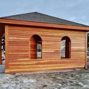 The Loreto Pavilion (Options: 20' L x 20' W, No Privacy Panels, Redwood, 10' H, Electrical Wiring Trim for 1 Post, 4-Post Anchor Kit for Gale-Wind, No Post Decorative Trim, 1 Ceiling Fan Base, No Curtain Rods, Transparent Premium Sealant, Custom Wall with Shutters). Photo Courtesy of A. Schurman of Cedar Falls, Iowa.