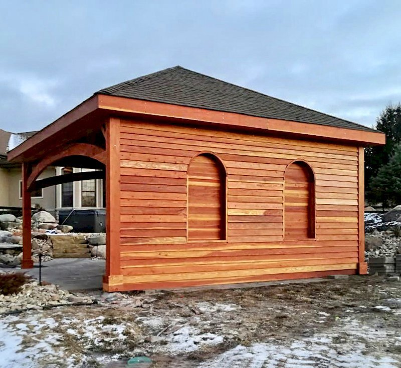 The Loreto Pavilion (Options: 20' L x 20' W, No Privacy Panels, California Redwood, 10' H, Electrical Wiring Trim for 1 Post, 4-Post Anchor Kit for Gale-Wind, No Post Decorative Trim, 1 Ceiling Fan Base, No Curtain Rods, Transparent Premium Sealant, Custom Wall with Shutters). Photo Courtesy of A. Schurman of Cedar Falls, Iowa.