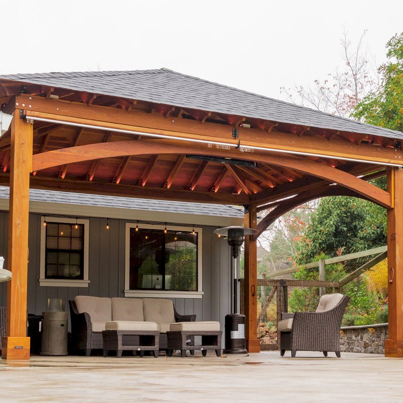 The Loreto Pavilion (Options: 24' L x 18' W, No Privacy Panels, California Redwood, 10' H, Electrical Wiring for 1 Post, 4-Post Anchor Kit for Concrete, No Post Decorative Trim, 1 Ceiling Fan Base, 2 Curtain Rods, Transparent Premium Sealant). Photo Courtesy of J. McLauglin of Santa Rosa, California.
