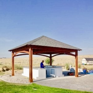 The Loreto Pavilion (Options: 18' L x 14' W, No Privacy Panels, Redwood, 9' H, 2 Electrical Wiring Trims, 4-Post Anchor Kit for Concrete, Vertical Post Decorative Trims, 1 Ceiling Fan Base, No Curtain Rods, Transparent Premium Sealant). Photo Courtesy of S. Whitley of Moses Lake, Washington.