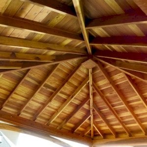 The Loreto Pavilion (Options: 18' L x 14' W, No Privacy Panels, California Redwood, 9' H, 2 Electrical Wiring Trims, 4-Post Anchor Kit for Concrete, Vertical Post Decorative Trims, 1 Ceiling Fan Base, No Curtain Rods, Transparent Premium Sealant). Photo Courtesy of S. Whitley of Moses Lake, Washington.