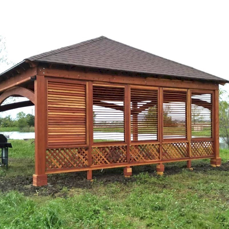 The Loreto Pavilion (Options: 24' L x 18' W, 1 Privacy Wall [Louvered with 2 ft of Lattice at the Bottom], California Redwood, 9.5' H, No Electrical Wiring Trim, 4-Post Anchor Kit for Gale-Wind, No Post Decorative Trim, 1 Ceiling Fan Base, 3 Curtain Rods, Transparent Premium Sealant). Photo Courtesy of D. Wisnosky of Plainfield, Illinois.