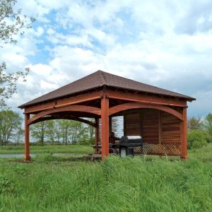 The Loreto Pavilion (Options: 24' L x 18' W, 1 Privacy Wall [Louvered with 2 ft of Lattice at the Bottom], Redwood, 9.5' H, No Electrical Wiring Trim, 4-Post Anchor Kit for Gale-Wind, No Post Decorative Trim, 1 Ceiling Fan Base, 3 Curtain Rods, Transparent Premium Sealant). Photo Courtesy of D. Wisnosky of Plainfield, Illinois.