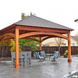 The Loreto Pavilion (Options: 20ft L x 20ft W, No Privacy Panels, Redwood, 10ft H, Electrical Wiring for 2 Posts, 4-Post Anchor Kit for Gale Wind, No Post Decorative Trim, 1 Ceiling Fan Base, No Curtain Rods, Transparent Premium Sealant.).