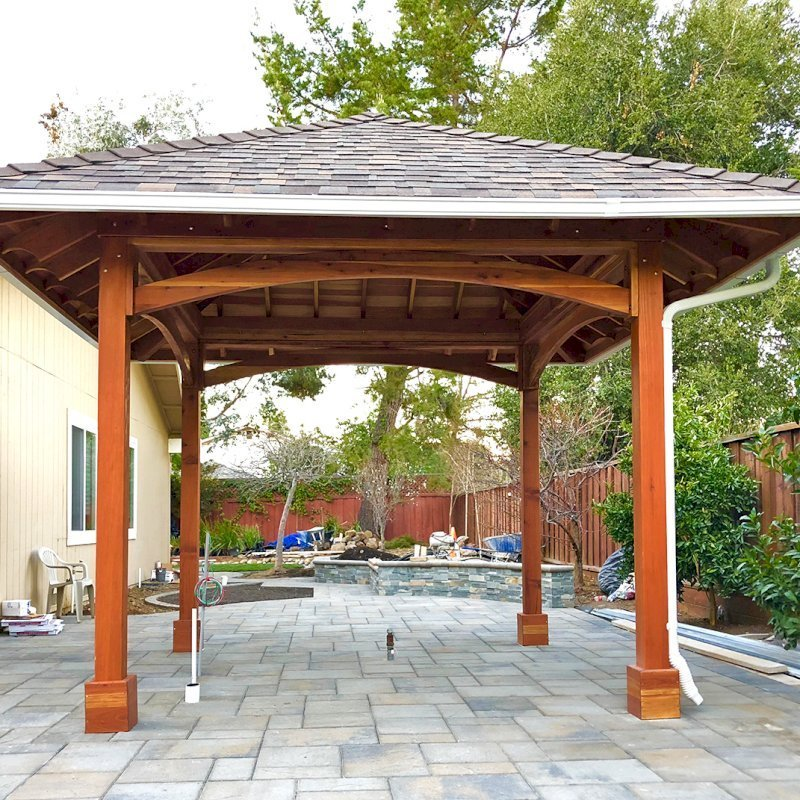 The Loreto Pavilion (Options: 14' x 14', California Redwood, Post Anchor Kit for Gale-Wind, 1 Electrical Wiring Trim Kit, 2ft Overhangs by Custom Request, Transparent Premium Sealant). Gutters added by Forever Redwood install team and can be added to any pavilion by request. Photo Courtesy of B. Hirschbeck of Los Altos, CA.