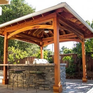The Loreto Pavilion (Options: 14' x 14', Redwood, Post Anchor Kit for Gale-Wind, 1 Electrical Wiring Trim Kit, 2ft Overhangs by Custom Request, Transparent Premium Sealant). Gutters added by Forever Redwood install team and can be added to any pavilion by request. Photo Courtesy of B. Hirschbeck of Los Altos, CA.