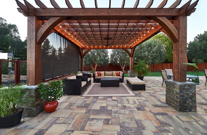 The Montvale Pergola (Options: 18' x 18', California Redwood, Post Anchoring for Concrete, Electrical Wiring Trim Kit for 2 Posts, 1 Ceiling Fan Base, No Curtain Rods, No Privacy Panels, 10' Post, Transparent Premium Sealant). Photo Courtesy of M. Butler of Napa, CA.