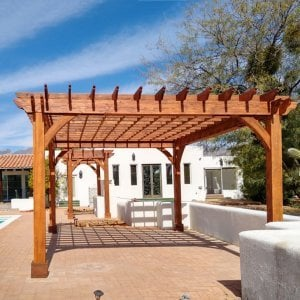 "The Montvale Pergolas (Options: 14' x 8' & 20' x 16', Douglas-fir, Electrical Wiring Trim for 1 Post, Rafters at 16"", Post Anchoring for Gale-Wind, No Ceiling Fan Base, No Privacy Panels, 10' Post, Transparent Premium Sealant). Photo courtesy of M. Simpson of Tucson, Arizona."