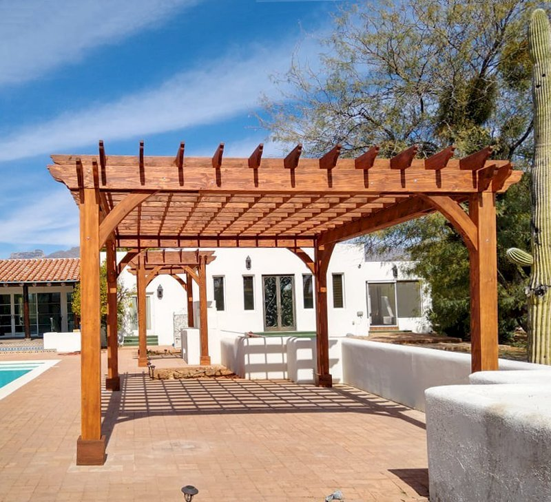 """The Montvale Pergolas (Options: 14' x 8' & 20' x 16', Douglas-fir, Electrical Wiring Trim for 1 Post, Rafters at 16"""", Post Anchoring for Gale-Wind, No Ceiling Fan Base, No Privacy Panels, 10' Post, Transparent Premium Sealant). Photo courtesy of M. Simpson of Tucson, Arizona."""