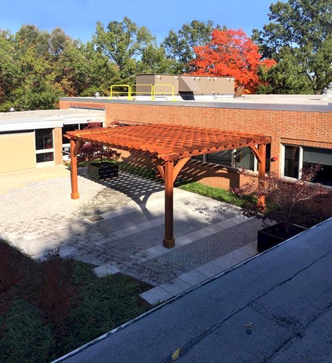 The Montvale Pergola (Options: 24' x 18', California Redwood, Post Anchoring for Gale-Wind, Pergola with Only 4 Posts Instead of 6 by Custom Request, No Ceiling Fan Base, No Curtain Rods, No Privacy Panels, 10' Post, Transparent Premium Sealant). Photo Courtesy of J. Cipolla of New Brunswick, New Jersey.