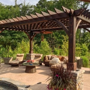 "The Montvale Pergola (Options: 20' x 14', Redwood, Electrical Wiring Trim for 1 Post, Rafters at 16"", Post Anchoring for Stone, Brick or Concrete, Ceiling Fan Base, No Privacy Panels, 8.5' Post, Coffee-Stain Premium Sealant). Photo courtesy of William H. of Montvale, NJ."