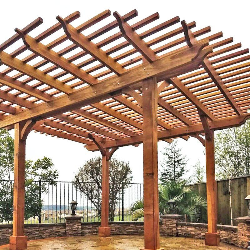 """The Round Pergola (Options: 16' Diameter, No Privacy Panel, California Redwood, Open Roof Slats at 6"""", 9.5ft Post height, Include Electrical Wiring Trim for 2 Posts, 4-Post Anchor Kit for Stone or Concrete, No Post Decorative Trim, No Ceiling Fan Base, No Curtain Rods, Transparent Premium Sealant). Photo courtesy of Harish B. of Dublin, CA"""