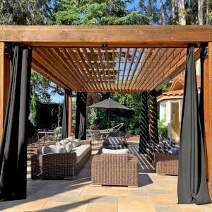 The Silverado Modern Pergola (Options: 6x6 Post Thickness, Standard Roof Stye, 20'L x 14'W, No Privacy Panels, California Redwood, No Rain Guard, 9ft Post Height, No Electrical Wiring Trim, 4 Post Anchor Kit for Concrete, 4 Curtain Rods, No Ceiling Fan Base, Transparent Premium Sealant). Photo Courtesy of B. Walsh of Atherton, California.
