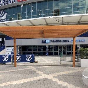 "The Silverado Modern Pergola (options: 20' L, 20' W, Douglas-fir, No Electrical Wiring Trim, 7 1/4"" x 7 1/4"" Posts, No Privacy Panels, No Curtain Rods, 9.5' Post Height, Transparent Premium Sealant). Photo Courtesy of The Tampa Bay Lightning NHL Team."