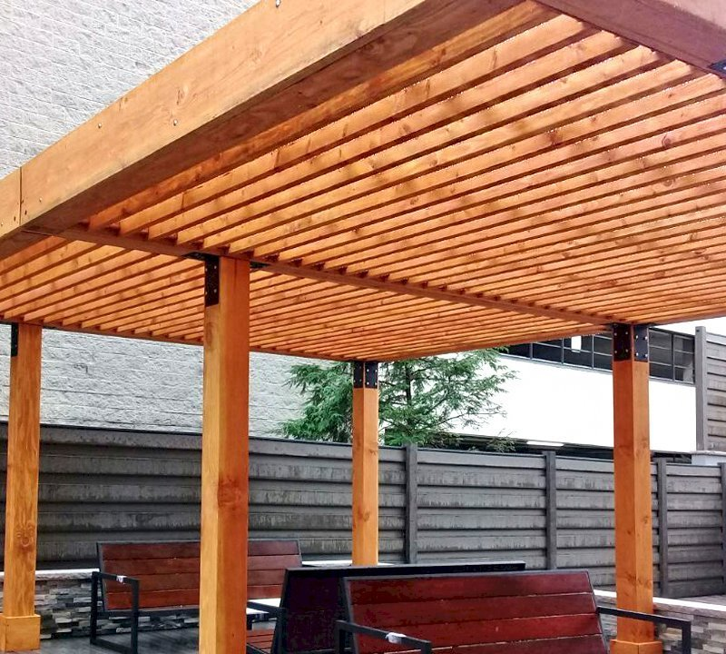 """The Silverado Modern Pergola (options: 15' L, 22' W, Douglas-fir, No Electrical Wiring Trim, with 1 3/4"""" x 11 1/4"""" Roof Support Timbers and 7 1/4"""" x 7 1/4"""" Posts, 6 Post Anchor Kit for Gale-Wind, No Privacy Panels, No Curtain Rods, 9' Post Height, Transparent Premium Sealant). Photo Courtesy of M. Zahler of Fort Lee, NJ."""