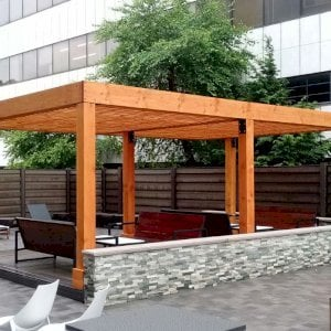 "The Silverado Modern Pergola (options: 15' L, 22' W, Douglas-fir, No Electrical Wiring Trim, with 1 3/4"" x 11 1/4"" Roof Support Timbers and 7 1/4"" x 7 1/4"" Posts, 6 Post Anchor Kit for Gale-Wind, No Privacy Panels, No Curtain Rods, 9' Post Height, Transparent Premium Sealant). Photo Courtesy of M. Zahler of Fort Lee, NJ."