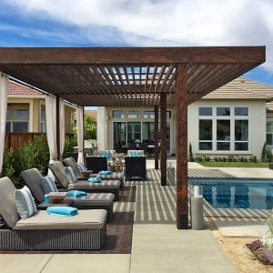 "The Silverado Modern Pergola (options: 30'-8"" L, 16' W, Redwood, No Electrical Wiring Trim, width 1 3/4"" x 11 1/4"" Roof Support Timbers and 7 1/4"" x 7 1/4"" Posts, 6 Post Anchor Kit for Gale-Wind, No Privacy Panels, No Curtain Rods, 10' Post Height, Coffee-Stain Premium Sealant). Photo Courtesy of B. Aronson of Lincoln, CA."
