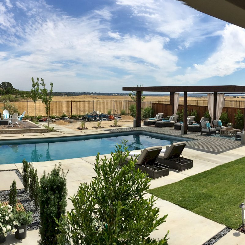 """The Silverado Modern Pergola (options: 30'-8"""" L, 16' W, California Redwood, No Electrical Wiring Trim, width 1 3/4"""" x 11 1/4"""" Roof Support Timbers and 7 1/4"""" x 7 1/4"""" Posts, 6 Post Anchor Kit for Gale-Wind, No Privacy Panels, No Curtain Rods, 10' Post Height, Coffee-Stain Premium Sealant). Photo Courtesy of B. Aronson of Lincoln, CA."""