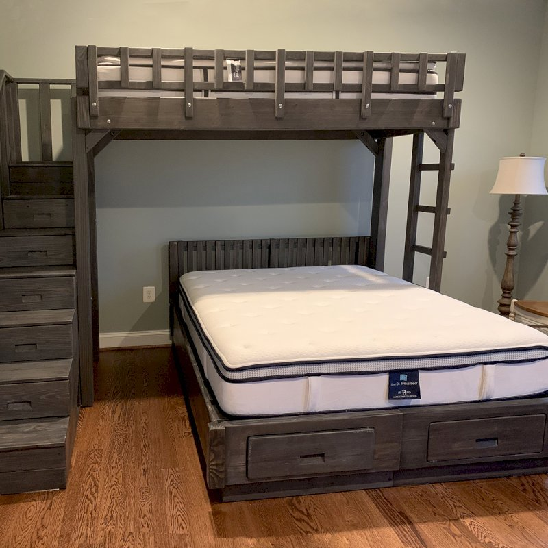 The Stairway Bunk Set (Options: Twin Top Bed, Queen Bottom Bed, Redwood, Stairway with Drawers on South and Ladder on North, Standard Headboard, Add 2 Drawers to Bottom Bed, Standard Safety Rails, Custom Stain). Photo Courtesy of M. Ocadiz of Glenwood, Maryland.