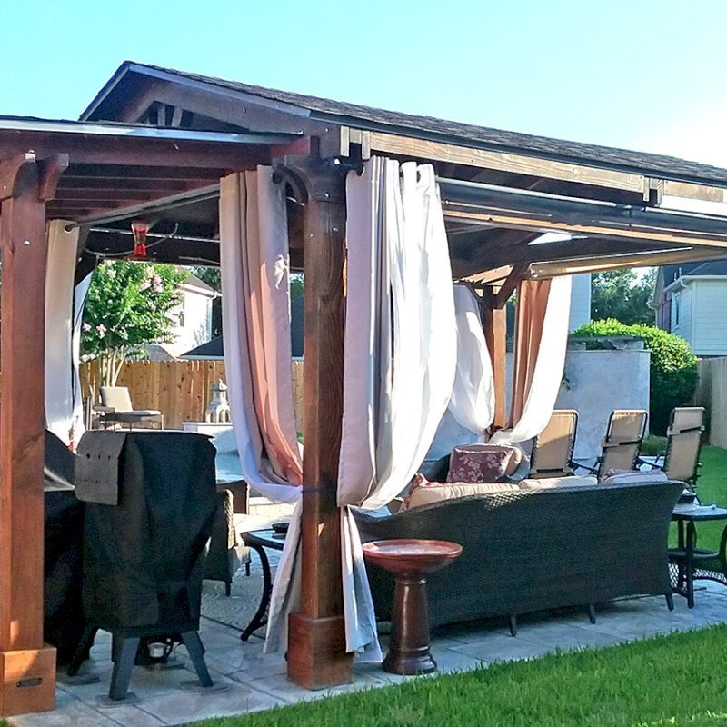 The Sunset Patio Pavilion Attached to a Del Norte Pavilion (Options: 10' x 5', Douglas-fir, No Ceiling Fan Base, No Electrical Wiring Trim Kit, 2-Post Anchor Kit for Concrete, Transparent Premium Sealant). Photo Courtesy of Jennifer Grizzle of Katy, Texas.