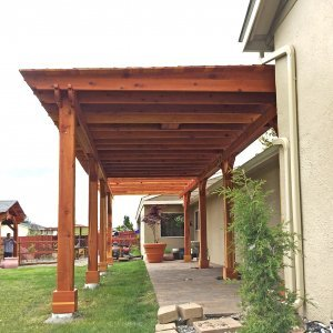 The Sunset Patio Pavilion (Options: 24' x 12', California Redwood, One Ceiling Fan Base, Electrical Wiring Trim Kit for 1 Post, Gale-Wind Anchors for 8 Posts, 8 x 8 Posts by Custom Request, Transparent Premium Sealant) with a 12' x 14' Garden Pergola Attached. Photo Courtesy of G. Scotzin of Pasco, WA.