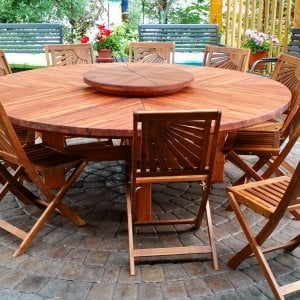 The Sunset Patio Table (Options:7' Diameter, Table Alone, Mosaic Eco-Wood, Standard Tabletop, Lazy Susan, No Umbrella Hole, Transparent Premium Sealant). Custom Request: Lazy Susan are in Olgrowth Wood, Chairs not from Forever Redwood. Photo Courtesy of John Farkas of Vida, Oregon.