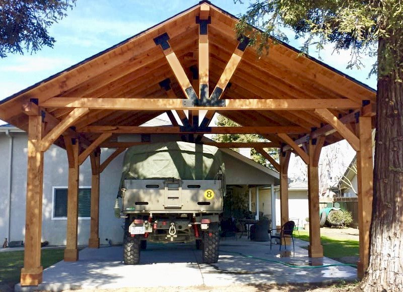 The Thick Timber Toledo Wood Pavilion  (Options: 27' L x 25' W, Douglas-fir, 6-Post Anchor Kit for Gale-Wind, Electrical Wiring Trim for 2 Posts, 8 x 8 Supports and Posts, 8 x 8 Rafters, 2 Fan Bases, Transparent Premium Sealant). Photo Courtesy of T. Lane of Kingsburg, CA.