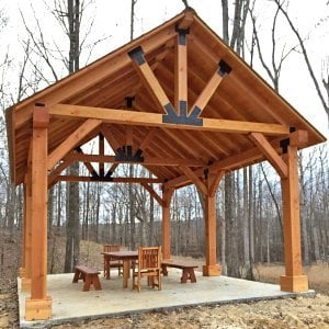 The Thick Timber Toledo Wood Pavilions (Options: 26' L x 20' W, Douglas-fir, 6-Post Anchor Kit for Gale-Wind, Electrical Wiring Trim for 3 Posts, 10 x 10 Supports and Posts, 8 x 8 Rafters, Transparent Premium Sealant). Photo Also Shows a Patio Table Set with Side Benches and End Chairs. Photo Courtesy of M. Turner of Thaxton, MS.