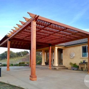 The Traditional Wooden Garden Pergola & Loreto Pavilion (Options: 16' L x 20' W, Attached to a 20' x 20' Loreto Pavilion, California Redwood, No Electrical Wiring Trim, Lattice Roof, Widthwise Roof Support Timbers, 6-Post Anchor Kit for Gale-Wind, No Ceiling Fan Base, No Privacy Panels, No Curtain Rods, 9.5' Post Height, Transparent Premium Sealant). Photo Courtesy of R. Offenbach of Ione, CA.