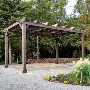 The Traditional Wooden Garden Pergola (Options: 16' L x 12' W, California Redwood, No Electrical Wiring Trim, Lattice Roof, Lengthwise Roof Support Timbers, 4-Post Anchor Kit for Stone, No Ceiling Fan Base, No Privacy Panels, No Curtain Rods, 9' Post Height, Custom Finish). Photo Courtesy of B. Savard of San Rafael, CA.
