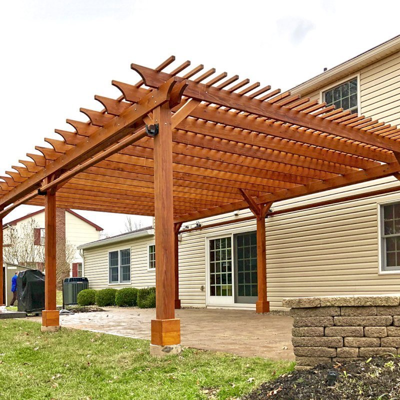 """The Traditional Wooden Garden Pergola (Options: 26' L x 18' W, Mature Redwood, 2 Electrical Wiring Trims, Open Roof with Slats at 6"""", Rafters at 18"""", 6-Post Anchor Kit for Concrete, No Ceiling Fan Base, No Privacy Panels, No Post Decorative Trims, 2 Curtain Rod, 9' Post Height, Transparent Premium Sealant). Photo Courtesy of H. Wittreich of Somerset, New Jersey."""