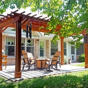 "The Traditional Wooden Garden Pergola (Options: 10' L x 20' W, California Redwood, No Electrical Wiring Trim, Open Roof with Slats at 12"", Rafters at 18"", 4-Post Anchor Kit for Concrete, Vertical Post Decorative Trim, No Ceiling Fan Base, No Privacy Panels, No Curtain Rods, Transparent Premium Sealant). Photo Courtesy of J. Karibian of Saint Charles, Missouri."