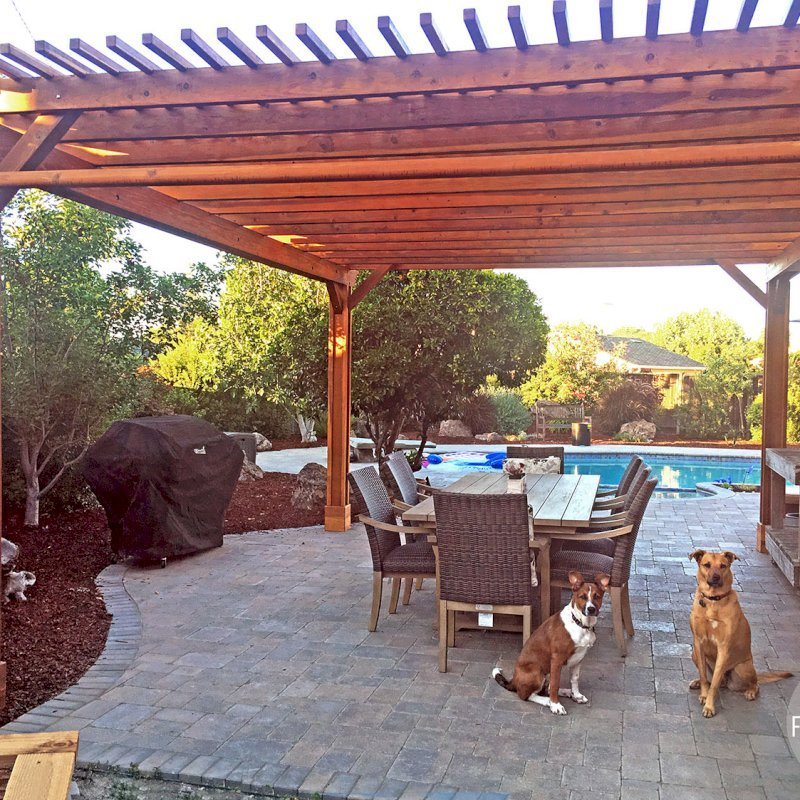 "The Traditional Wooden Garden Pergola (Options: 20' L x 16' W, California Redwood, 2 Electrical Wiring Trims, Open Roof with Slats at 6"", Rafters at 18"", 4-Post Anchor Kit for Concrete, 1 Ceiling Fan Base, No Privacy Panels, Vertical Post Decorative Trims, 1 Curtain Rod, 9' Post Height, Transparent Premium Sealant). Photo Courtesy of Jason Irwin of Campbell, California."