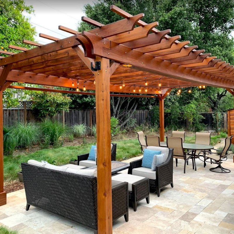 "The Traditional Wooden Garden Pergola (Options: 25' L x 14' W, California Redwood, Electrical Wiring Trim for 2 Posts, Open Roof with Slats at 18"", with 2' Overhang by Custom Request, Rafters at 12"", 4-Post Anchor Kit for Gale-Wind, No Ceiling Fan Base, No Privacy Panels, Curtain Rods on 2 Sides, 9.5' Post Height, Transparent Premium Sealant). Photo Also Shows a Storage Shed. Photo Courtesy of J. Lewis of Mountain View, CA."