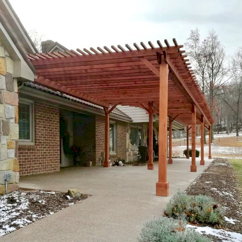 "The Traditional Wooden Garden Pergola (Options: 22' L x 14.5' W & 42' L x 8' W [Connected], Mature Redwood, No Electrical Wiring Trim, Open Roof with Slats at 18"", Rafters at 18"", Lengthwise Roof Support Timbers, 9-Post Anchor Kit for Stone, No Ceiling Fan Base, No Privacy Panels, No Curtain Rods, 9.5' Post Height, Transparent Premium Sealant). Photo Courtesy of K. Feliciani of Greensburg, Pennsylvania."