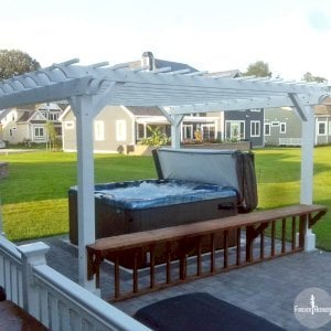 "The Traditional Wooden Garden Pergola (Options: 16' L x 14' W, Douglas-fir, No Electrical Wiring Trim, Open Roof with Slats at 12"", Rafters at 18"", 4-Post Anchor Kit for Concrete, No Ceiling Fan Base, No Privacy Panels, No Curtain Rods, 9' Post Height, Off-White Oil-Based Primer). Photo Courtesy of V. Yzaguirre of Lewes, Delaware."