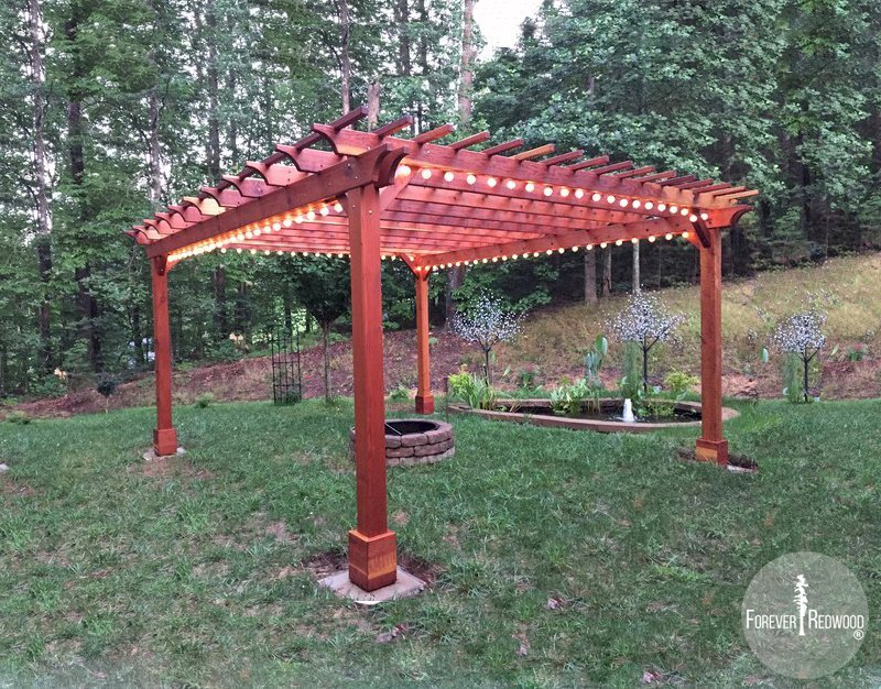 "The Traditional Wooden Garden Pergola (Options: 18' L x 16' W, California Redwood, Electrical Wiring Trim for 1 Post, Open Roof with Slats at 12"", Rafters at 18"", Lengthwise Roof Support Timbers, 4-Post Anchor Kit for Gale-Wind, No Ceiling Fan Base, No Privacy Panels, No Curtain Rods, 9' Post Height, Transparent Premium Sealant). Photo Courtesy of A. Miller of Ellijay, Georgia."