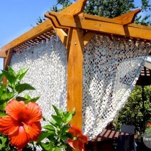 Add some fabric for a special touch. Garden Pergola (Options: 10' x 10', Mature Redwood, No Electrical Wiring Trim, Lattice Roof, 4-Post Anchor Kit for Stone, No Ceiling Fan Base, No Privacy Panels, No Curtain Rods, 9' Post Height, Transparent Premium Sealant).