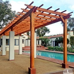"The Traditional Wooden Garden Pergola (Options: 40' L x 9' W, Douglas-fir, No Electrical Wiring Trim, Open Roof with Slats at 18"", Rafters at 18"", Lengthwise Roof Support, 8-Post Anchor Kit for Stone, No Ceiling Fan Base, No Privacy Panels, No Curtain Rods, 9.5' Post Height, Transparent Premium Sealant). Photo Courtesy of Emilio E. of Malibu, CA."